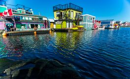 Floating Home Village colorful Houseboats Water Taxi Fisherman`s Wharf Reflection Inner Harbor, Victoria British Columbia Canada. Pacific Northwest. Area has stock image