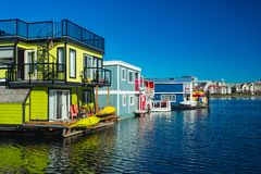 Floating Home Village colorful Houseboats Water Taxi Fisherman`s Wharf Reflection Inner Harbor, Victoria British Columbia Canada. Pacific Northwest. Area has stock images