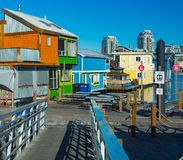 Floating Home Village colorful Houseboats Water Taxi Fisherman`s Wharf Reflection Inner Harbor, Victoria British Columbia Canada. Pacific Northwest. Area has royalty free stock image