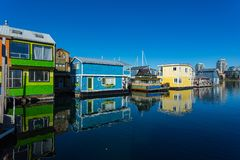 Floating Home Village Houseboats Fisherman`s Wharf Inner Harbor, Victoria British Columbia Canada.Area has floating homes, boats,. Piers, restaurants and stock image