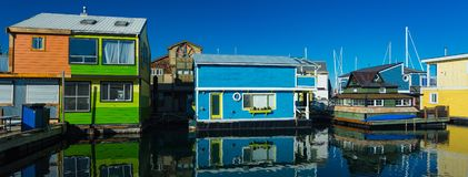Floating Home Village Houseboats Fisherman`s Wharf Inner Harbor, Victoria British Columbia Canada.Area has floating homes, boats,. Piers, restaurants and stock images