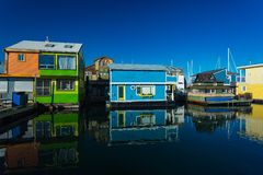 Floating Home Village Houseboats Fisherman`s Wharf Inner Harbor, Victoria British Columbia Canada.Area has floating homes, boats,. Piers, restaurants and royalty free stock images
