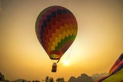 Floating Hot Air Balloon in Vang Vieng. A coloful hot air balloon is being released in Vang Viang royalty free stock photos