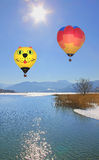Floating hot air balloons over lake tegernsee, germany Stock Images