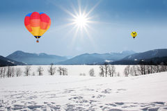 Floating hot air balloons over lake tegernsee, germany Royalty Free Stock Image