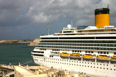 Floating Hotel. This photo shows the immense size of these cruise liners. This photo was taken from the top of the bastions surrounding Malta's capital,Valletta Stock Image