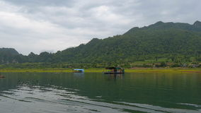 Floating hotel houses flowing through the idyllic rural landscape stock video footage