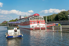 Floating Hotel on Moldava River - Prague - Czech Republic. PRAGUE - AUGUST 4: Along the banks of the Vltava River there are floating hotel and  restaurants to Stock Image