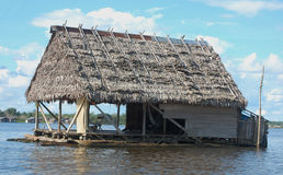 Floating house on Amazon river Stock Photo