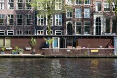 Floating house in Amsterdam Jordaan district Royalty Free Stock Image