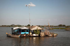 Floating house with an antenna. Stock Photos