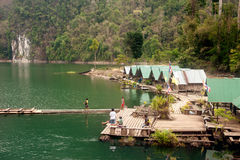 Floating house in Cheow Larn Lake (Ratchaprapa Dam). Royalty Free Stock Photography