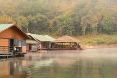 Floating house with fog in the morning. Thailand Stock Photos
