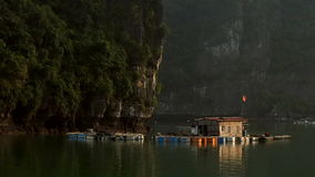Floating house in Halong Bay on sunset stock video footage