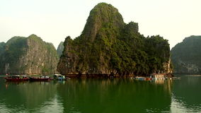 Floating house in Halong Bay on sunset stock video