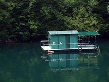 Floating house on lake. Stock Photo
