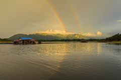 Floating House and Rainbow Stock Photography