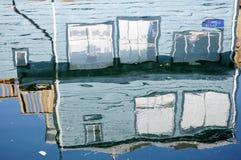 Floating house reflection Stock Images