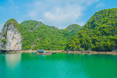 Floating house and rock island in Halong Bay Stock Images