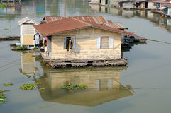 Floating  houseboat on the Sakakrung river in Thailand. Floating  houseboat on river in Thailand Stock Image