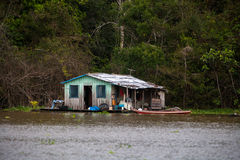 Floating houses in amazon river Stock Photography