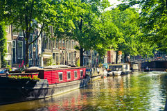 Floating houses in Amsterdam, Netherlands. Floating houses and barges in Amsterdam, Netherlands royalty free stock photos