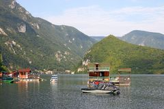 Floating houses and boats on river Royalty Free Stock Photo