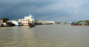 Floating houses. Cai Be. Vietnam Royalty Free Stock Photography