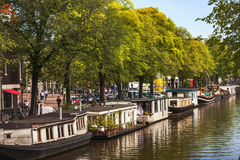 Floating houses on the canals of Amsterdam, Netherlands Royalty Free Stock Photo