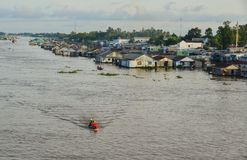 Floating houses in Chau Doc, Vietnam. Chau Doc, Vietnam - Sep 3, 2017. Floating houses with boat on river in Chau Doc, Vietnam. Chau Doc is a city in the heart Royalty Free Stock Photography