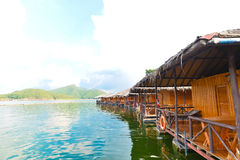 Floating houses on dam Stock Images