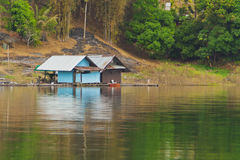 Floating houses in a lake Stock Photo