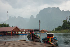 Floating houses and long tail boats at Chieou Laan lake Stock Image