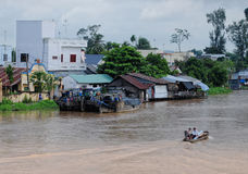 Floating houses on Mekong river in Tra Vinh, Vietnam Royalty Free Stock Photo