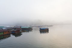 Floating houses in the mist Stock Photography