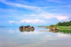 Floating houses on Tri An lake. NAI- VIETNAM: The floating houses on the lake with fishing boats in Tri An, Nai province, Vietnam. This lake is a reservoir for royalty free stock images