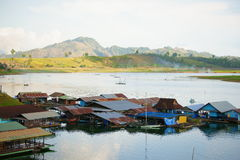Floating houses, wangka, mon minority village. Wangka, mon minority village inhabited by mon refugees from burma, on khao laem reservoir artificial lake stock images