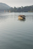 Floating hut in the river Stock Images