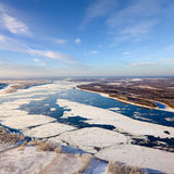 Floating ice floes are drifting on the great river Royalty Free Stock Photos