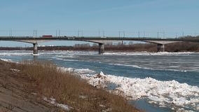 Ice floes float on the river in the spring during the ice drift. Floating ice floes on the river in the spring during the ice drift Sunny spring day congestion stock video footage