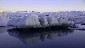 Free Floating Ice On Jokulsarlon Glacier Lake In Ultraviolet At Sunrise Stock Photography - 111938472