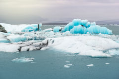 Floating icebergs and view to the glacier, ice lagoon Jokulsarlon, Iceland Stock Images
