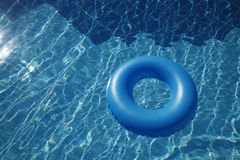 Floating inner tube in a pool Stock Photos
