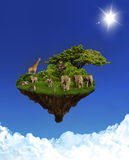 Floating Island with animals. Floating rock with african animals in clear blue sky Stock Photography