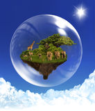Floating Island with animals in bubble. Floating rock with african animals in bubble  in clear blue sky Royalty Free Stock Photography