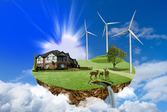 Floating Island, ecology concept. Modern energy consumption, floating Island with house and wind power station in the clouds Royalty Free Stock Photography