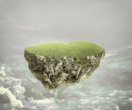 Floating island. Over a cloudy sky Stock Photography