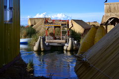 Floating Island Peru. Boat made by people from floating island on the Titicaca lake.This artificial islands are made out of reeds, same the boats Royalty Free Stock Photo