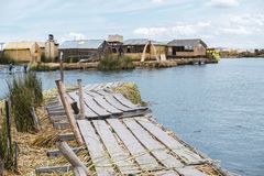 Floating island pier. Simple wooden floating island pier at lake Titicaca in Peru stock photos