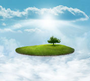 Floating Island with tree. Floating island in the clouds with single tree Royalty Free Stock Image